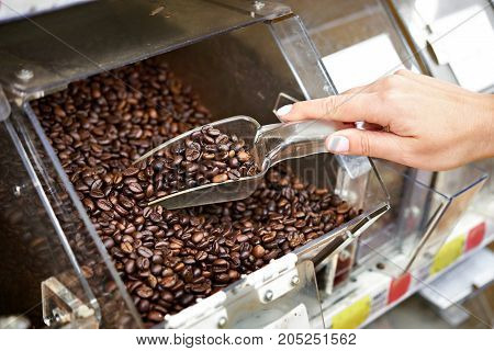 Buyer In Shop Buys Coffee Using Scoop For Products