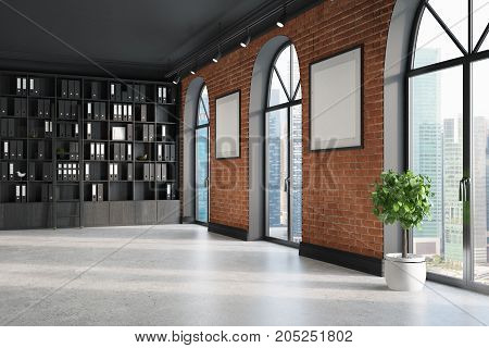 CEO office with brick and black walls a concrete floor tall windows and two framed posters. A bookcase with folders. 3d rendering mock up