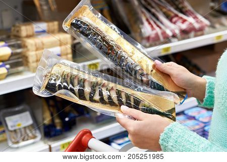 Buyer Chooses Smoked Fish Mackerel