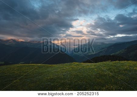 Landscape Of Georgian Mountains At Sunrise. Beautiful Clouds Over Mountains.