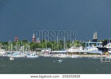 Fairhaven Massachusetts USA - June 22 2007: Summer storm darkening the sky over the Acushnet River