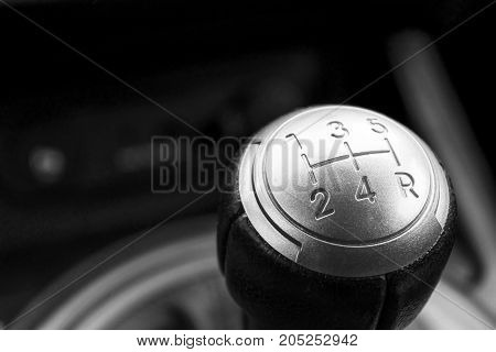 Abstract view of a gear lever, manual gearbox, car interior details. Black and white