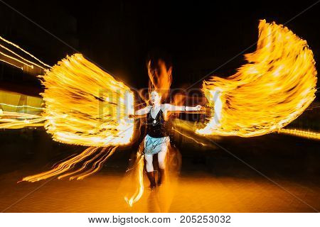Woman Juggles With Fire In Total Darkness