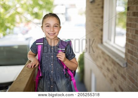 A Beautiful little girl with backpack ready back to school