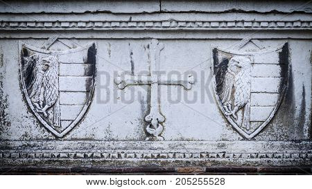 particular of the facade of a church with medieval symbol of noble people