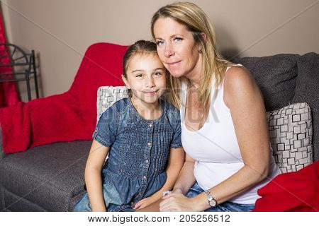 A mother and daughter portrait at home