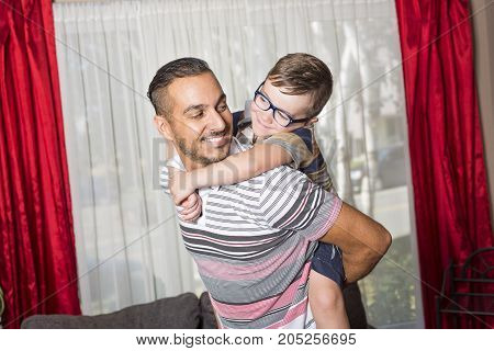 A Father and son having fun at home in living room
