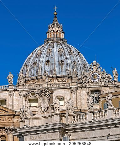 VATICAN ROME - ITALY JUNE 1 2017: The dome of St. Peter's Cathedral in Vatican City with tourists up on cupola.