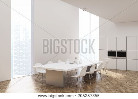 White And Wooden Kitchen With A Table, Ovens, Side