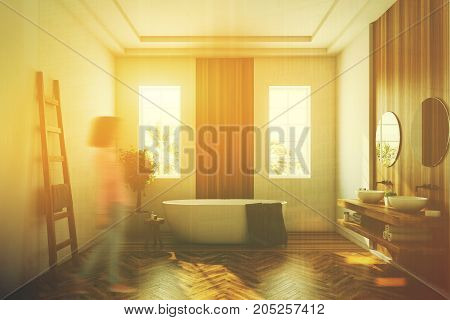 White and wooden bathroom interior with a wooden floor a white tub a tree in a pot two narrow windows and a ladder. Close up A woman 3d rendering mock up toned image double exposure