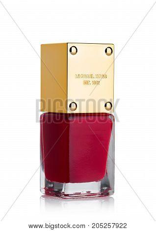 London, Uk - September 21, 2017: Red Nail Polish Bottle With Golden Top By Michael Kors On White