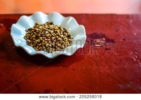 National cereal on a plate. Buckwheat grain. Grains of cereal on a plate at the table