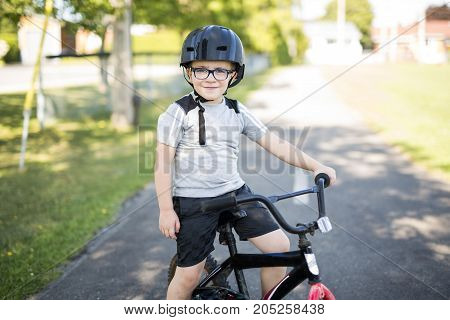 A 6-year old boy biking in the park
