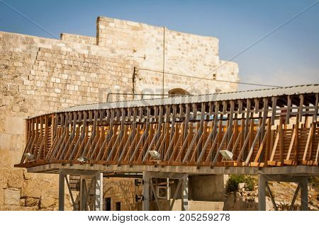 JERUSALEM, ISRAEL. September 15, 2017. The Mughrabi Bridge, a wooden bridge connecting the Western Wall plaza with the Mughrabi Gate of the Temple Mount in Jerusalem.