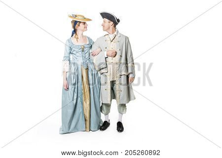 A beautiful couple in long medieval dress isolated on white