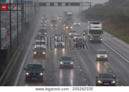 Redbourn UK - September 21 2017: Traffic on busy British motorway M1 in a bad rainy weather.