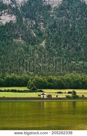House On The Bank Of Lake