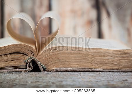 An old book with heart-shaped pages, horizontal view