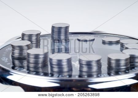 Coins With Plant And Clock, Isolated On White Background. Savings Concept