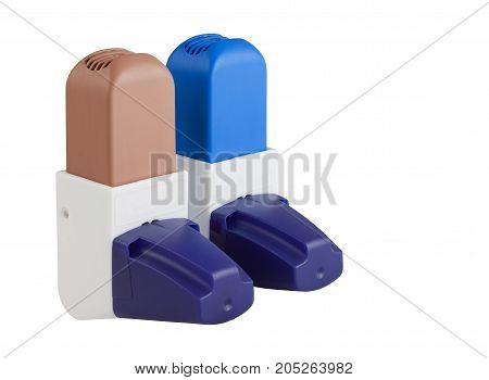 Blue and Brown Asthma Inhalers with caps isolated on white with clipping path