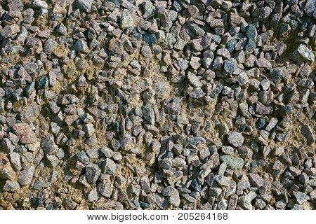 Texture of small stones and gray sand