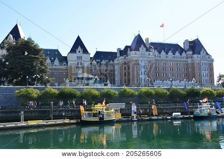 Victoria BC,Canada,September 2nd 2017.Victoria's inner harbor with water taxis the causeway and the iconic Empress hotel in the background.Come explore BC'S capital.