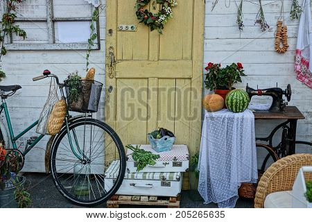 Home decoration in the yard near the wall with a door