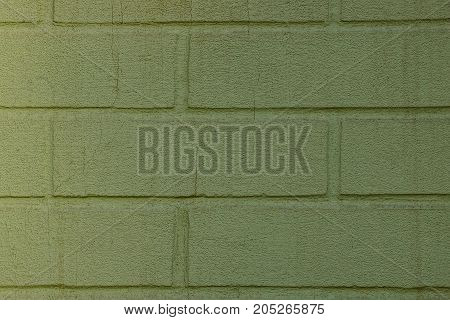 green texture of a fragment of brickwork on the wall of the house
