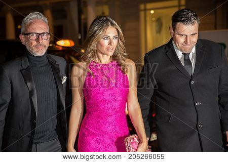 Elizabeth Hurley and designer Patrick Cox attends Harper's Bazaar Women Of The Year Wards 2016 at London's Claridge's Hotel