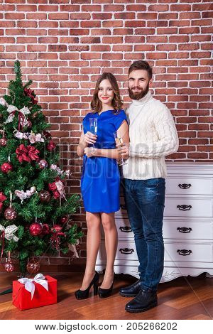 Shot Of A Young Happy Couple In Love Celebrating Christmas. Holidays And Celebration Concept.