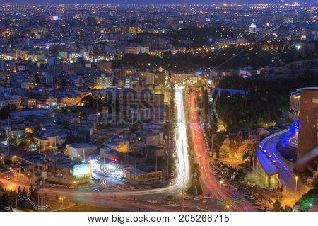 Fars Province Shiraz Iran - 18 april 2017: Aerial view of night cityscape highway traffic in nightfall.