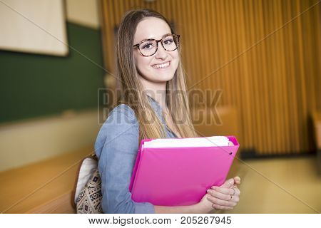 A shot of a woman college student studying on campus