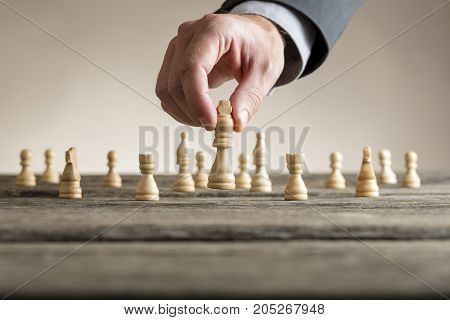 Businessman Playing Chess Moving White King Piece