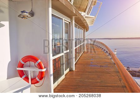 Wooden deck, life ring and beautiful seascape