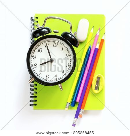 Colorful school supplies and alarm clock on white background. Top view, flat lay. Square image.