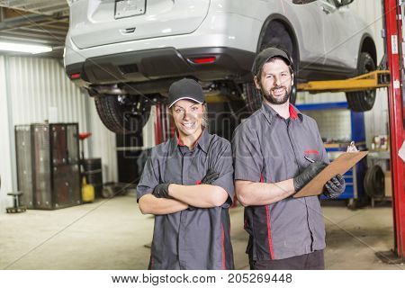 A Mechanic team working on car in his shop