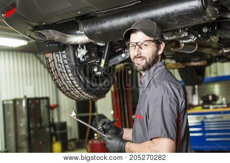 A Mechanic working on car in his shop