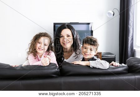A Portrait of beautiful mother and her childs at home