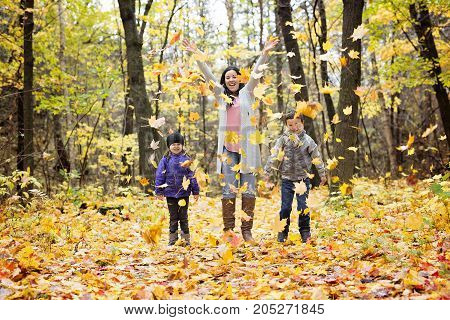 A Happy family having fun on beautiful autumn day