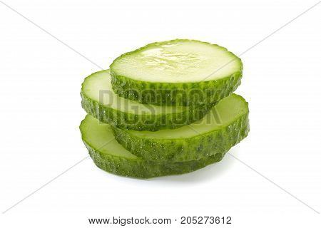 Stack of cucumber slices isolated on white background