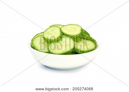 Bowl with cucumber slices isolated on white background