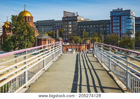 The city of Novosibirsk Siberia Russia - September 17 2017: a view of the Cathedral in the name of Alexander Nevsky to the railway pedestrian overpass