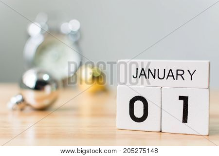 January 1 Calendar wood block with christmas ball decoration and clock on table New year resolution and goals concept