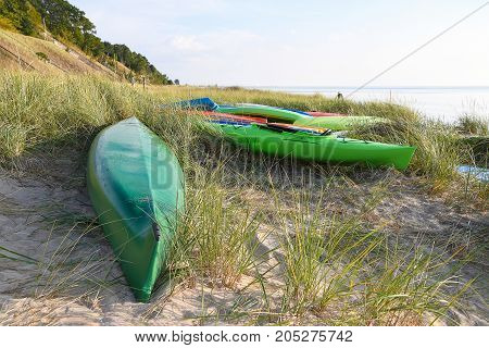 colorful kayaks in dune grass on Lake Michigan beach