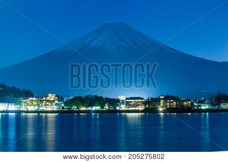 Mount Fuji and snow on peak at Kawaguchiko lake at night, Japan