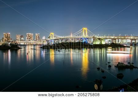 Beautiful view of Tokyo bay, the colorful rainbow bridge and Tokyo city background at Odaiba, Japan