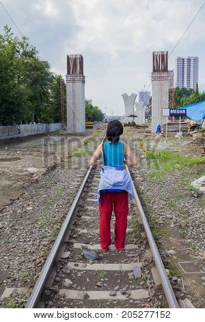 The traveler woman standing on Rail road