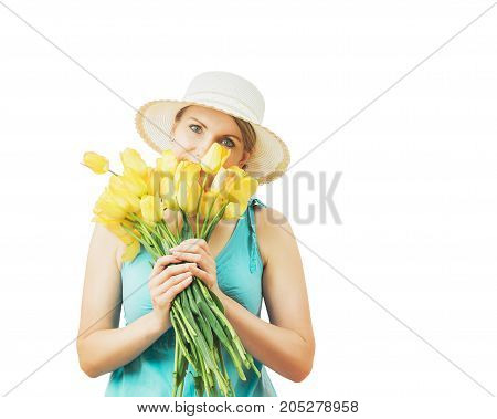 Woman in summer hat with a bouquet of tulips isolated on white background. Portrait of beautiful woman with flowers on white background.