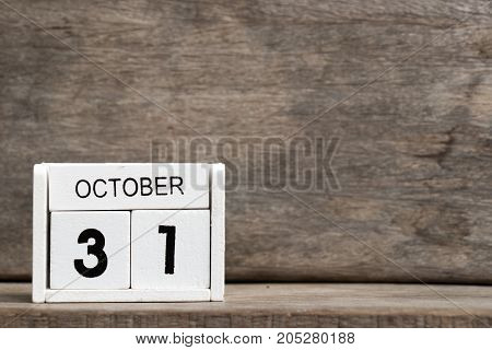 White block calendar present date 31 and month October on wood background (Halloween World savings day National unity in India)