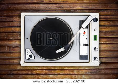 The Old Soviet Vinyl Player Isolated On Wooden Background.